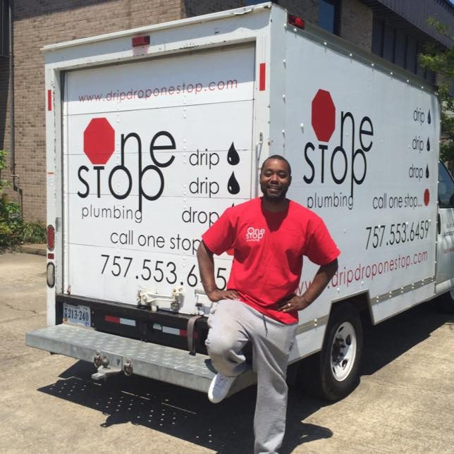 One Stop Plumbing's owner Nevie Sessoms in a red shirt standing in front of the One Stop Plumbing truck about Us